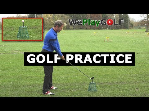 Golf Practice: Ball above the feet on the driving range