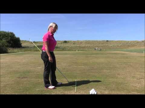 Golf swing plane improvement drill