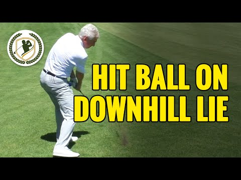 HOW TO HIT A GOLF BALL ON A DOWNHILL LIE