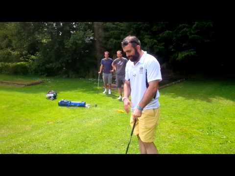 Flannels playing golf left handed