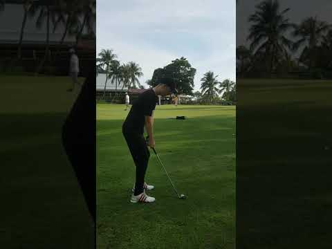 Practising golf chipping with 9 iron at Tropicana Malaysia